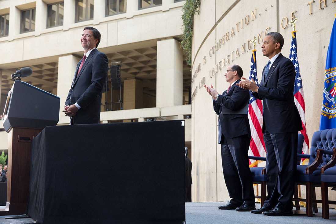 President Barack Obama and FBI Deputy Director Sean Joyce, center, applaud FBI Director James Comey, left, during his installation ceremony at the J. Edgar Hoover Building
