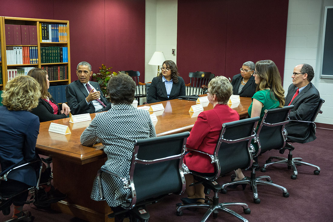 President Barack Obama holds a women's roundtable discussion prior to remarks on the economy at Rhode Island College in Providence, Rhode Island, Oct. 31, 2014. Labor Secretary Thomas Perez attends at right.