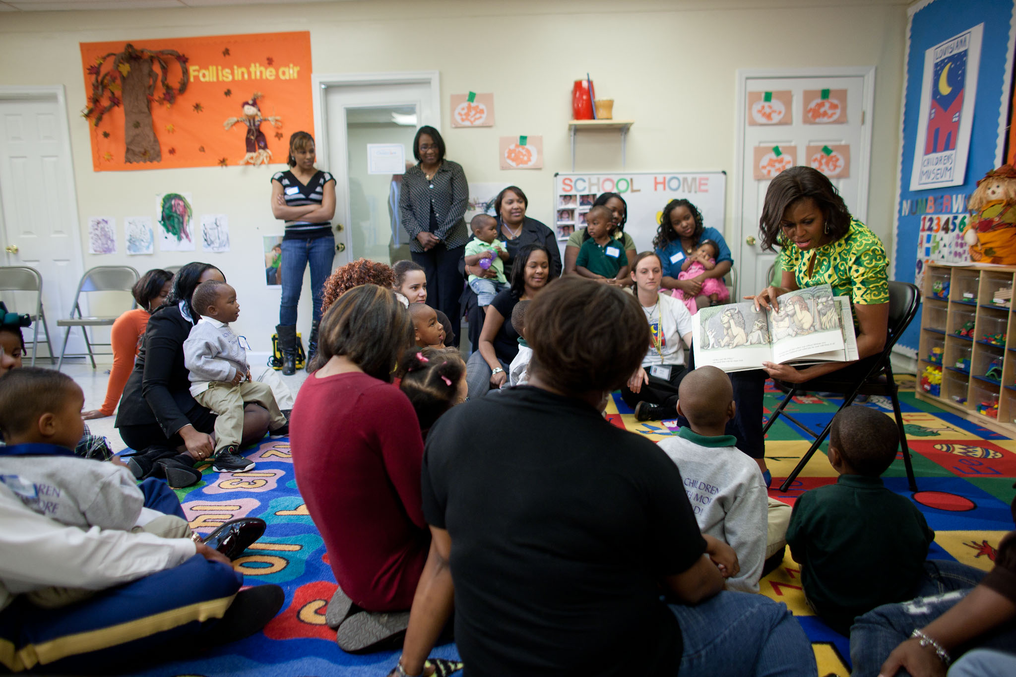 First Lady Michelle Obama reads to children at the Royal Castle Child Development Center