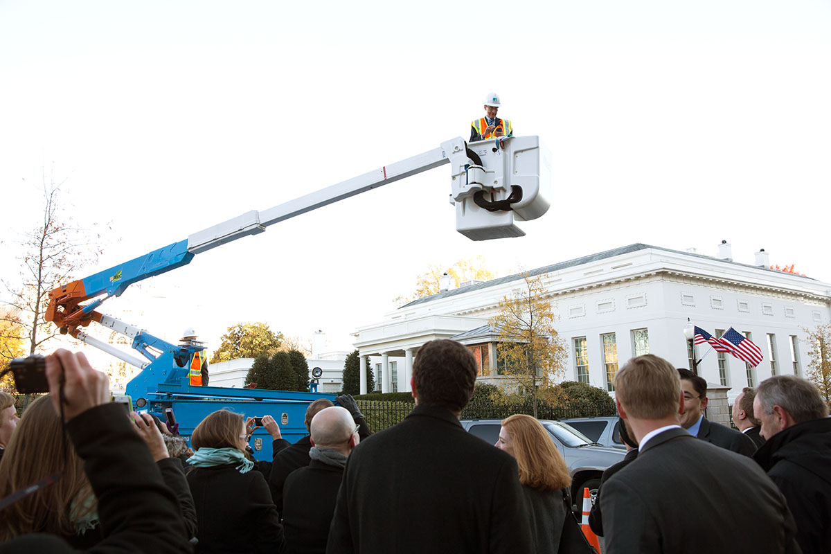 John Podesta operates the bucket on the new hybrid hydraulic lift power trucks on West Executive Dr.