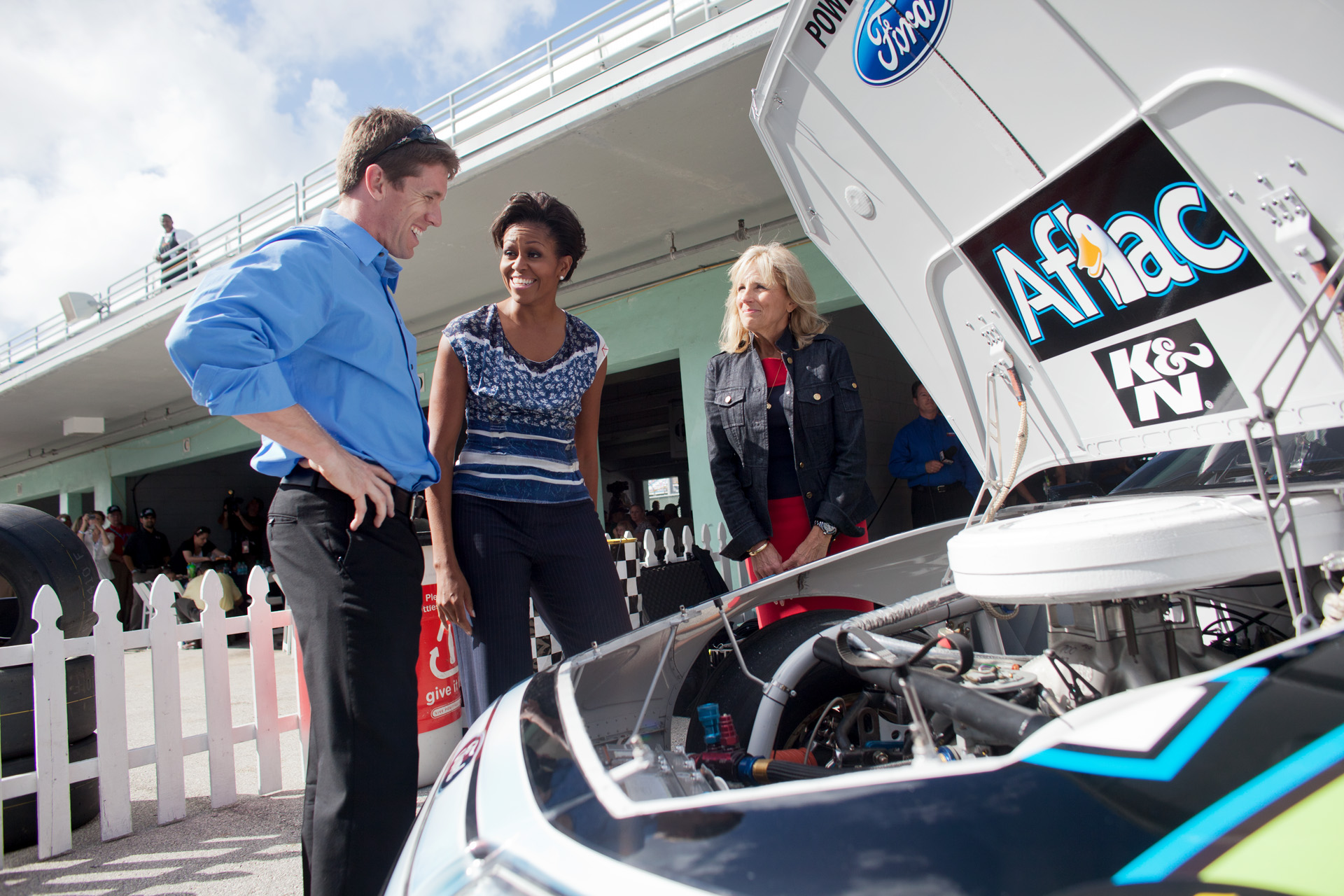 First Lady Michelle Obama and Dr. Jill Biden get a look under the hood of Carl Edwards' car at NASCAR race