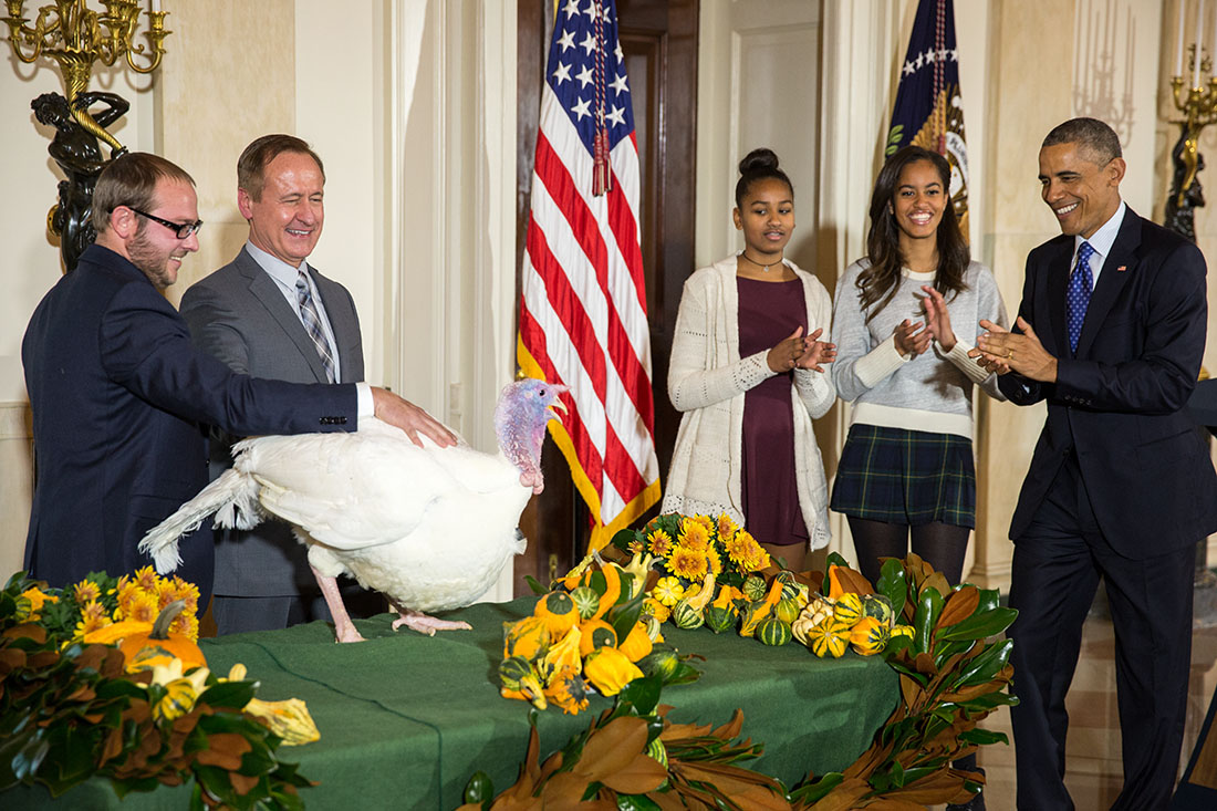 President Barack Obama, National Turkey Federation Chairman Gary Cooper; and son Cole Cooper participate in the annual National Thanksgiving Turkey pardon ceremony in the Grand Foyer of the White House, Nov. 26, 2014.