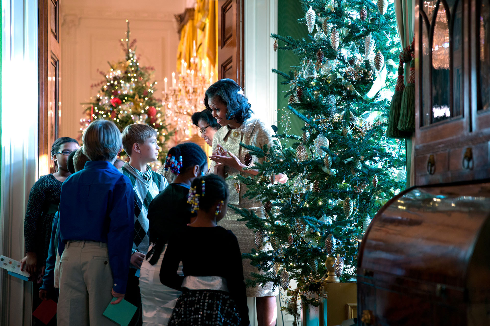 First Lady Michelle Obama talks with children of military families at the holiday press preview,