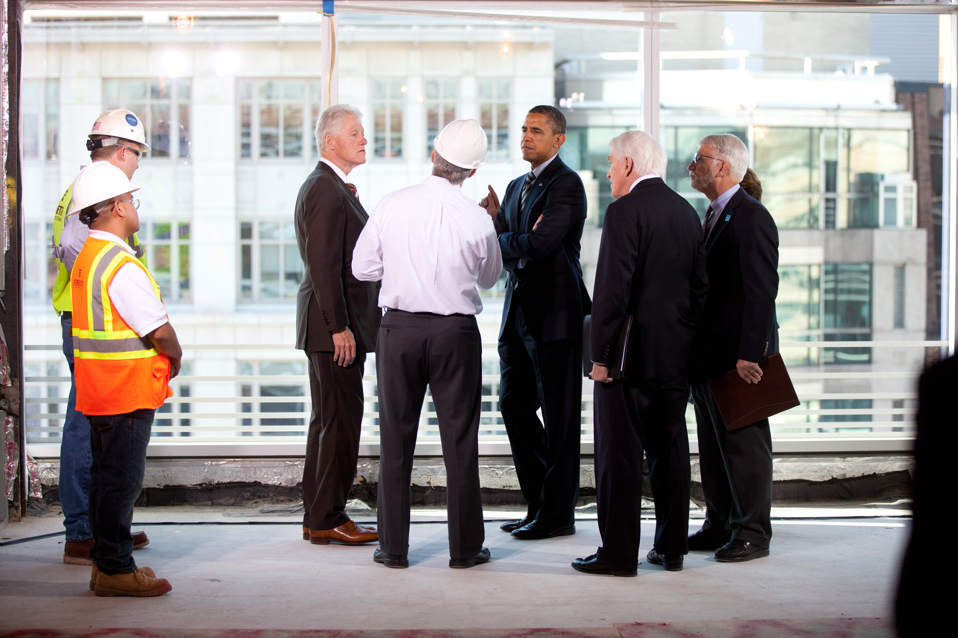 President Obama and President Clinton tour Transwestern Building