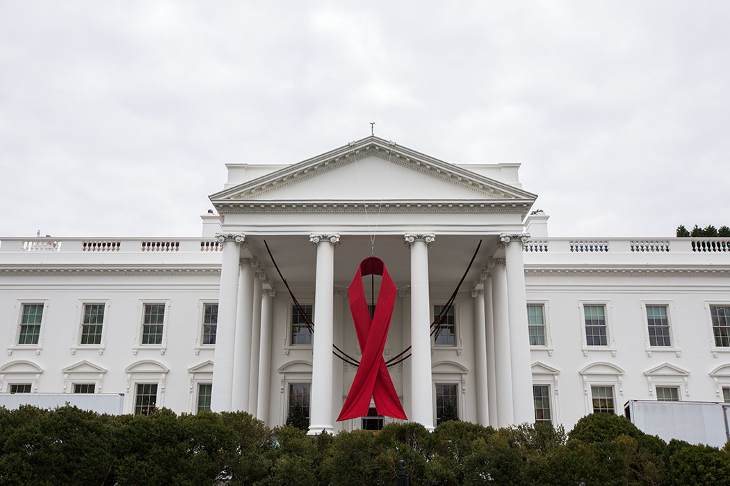 A red ribbon hangs from the North Portico of the White House on Dec. 2, 2013 to mark World AIDS Day