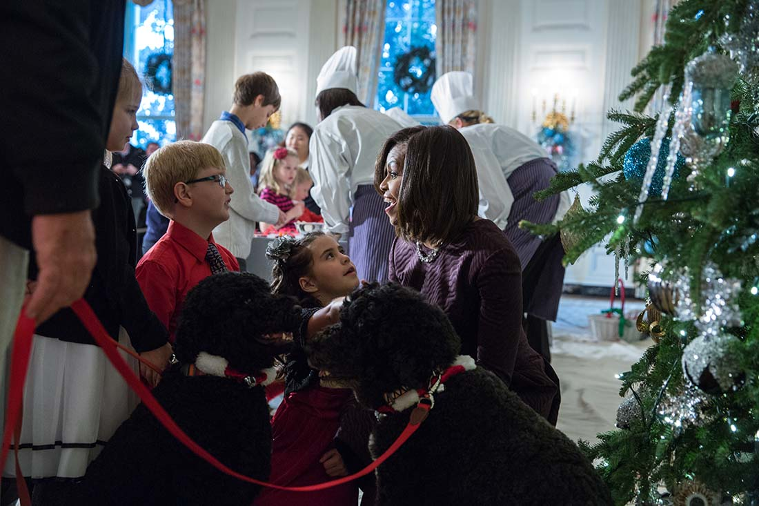 First Lady Michelle Obama and children of military families visit with surprise guests Obama family pets Bo and Sunny