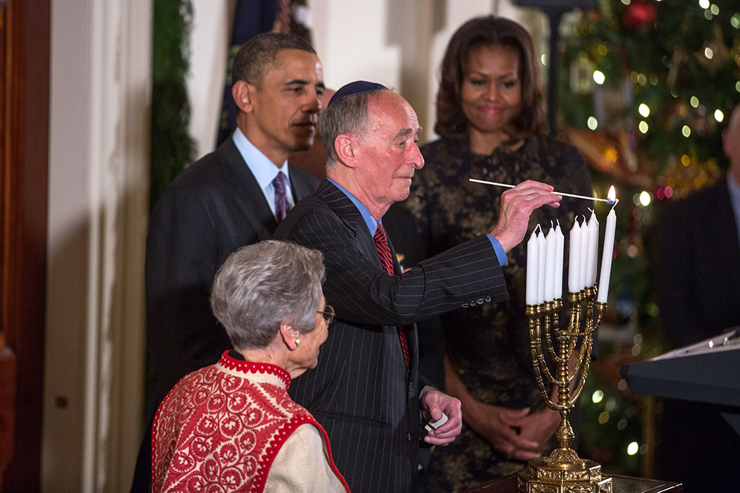 Holocaust survivors Margit Meissner and Martin Weiss participate in the Menorah lighting with President Barack Obama and First Lady Michelle Obama