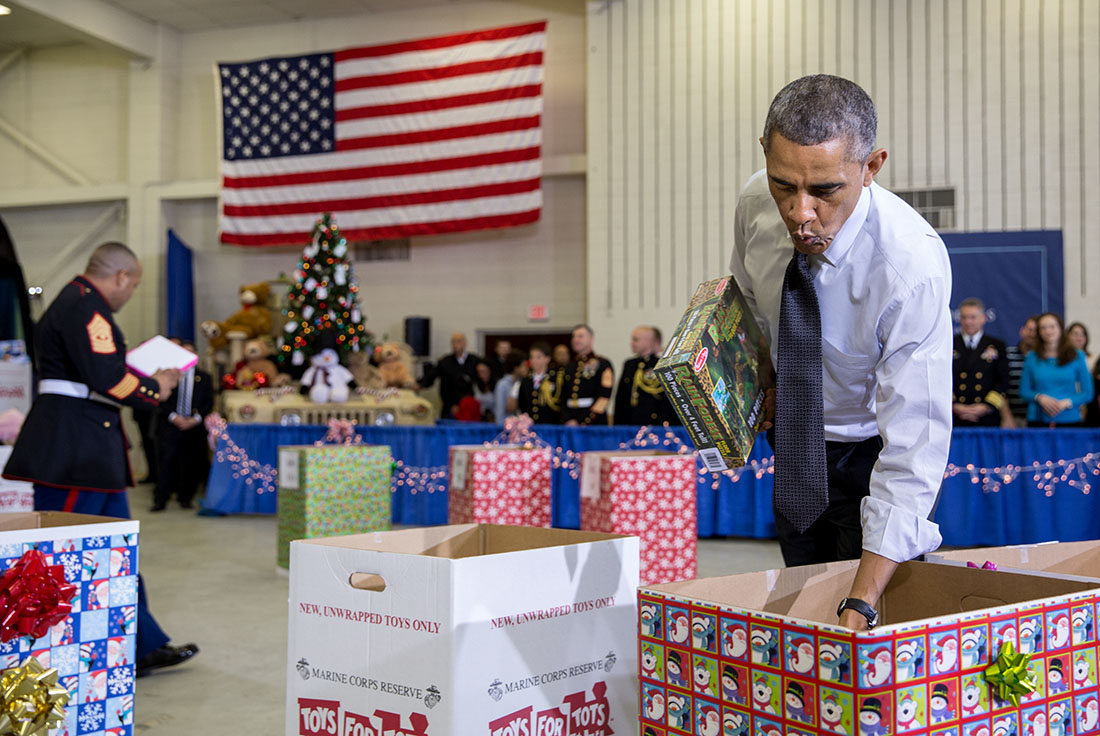 President Obama sorts toys with U.S. Marines and children at Toys for Tots event