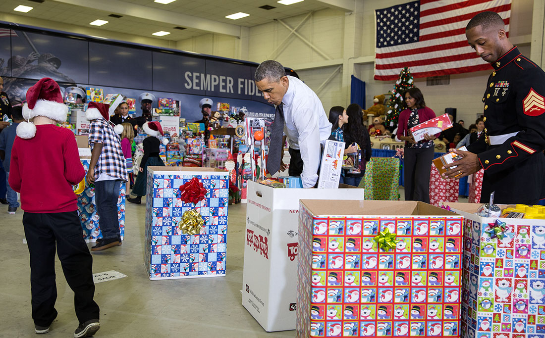 The President and First Lady sort toys with U.S. Marines and children at Toys for Tots event