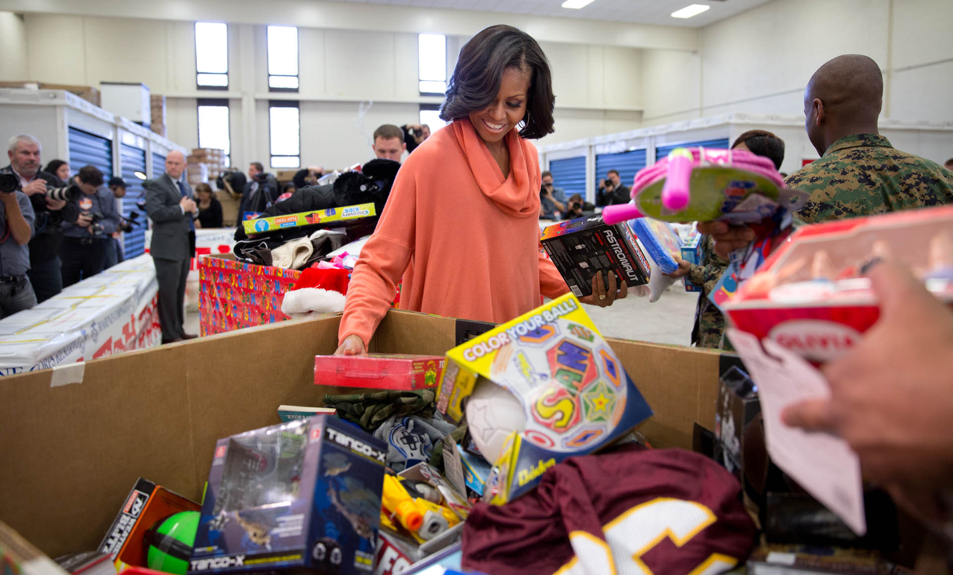 First Lady Michelle Obama helps sort toys at a Toys for Tots event, Dec. 11, 2012.