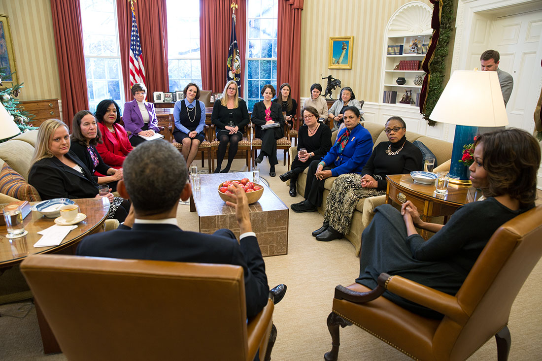 President Barack Obama and First Lady Michelle Obama meet with mothers regarding the Affordable Care Act in the Oval Office
