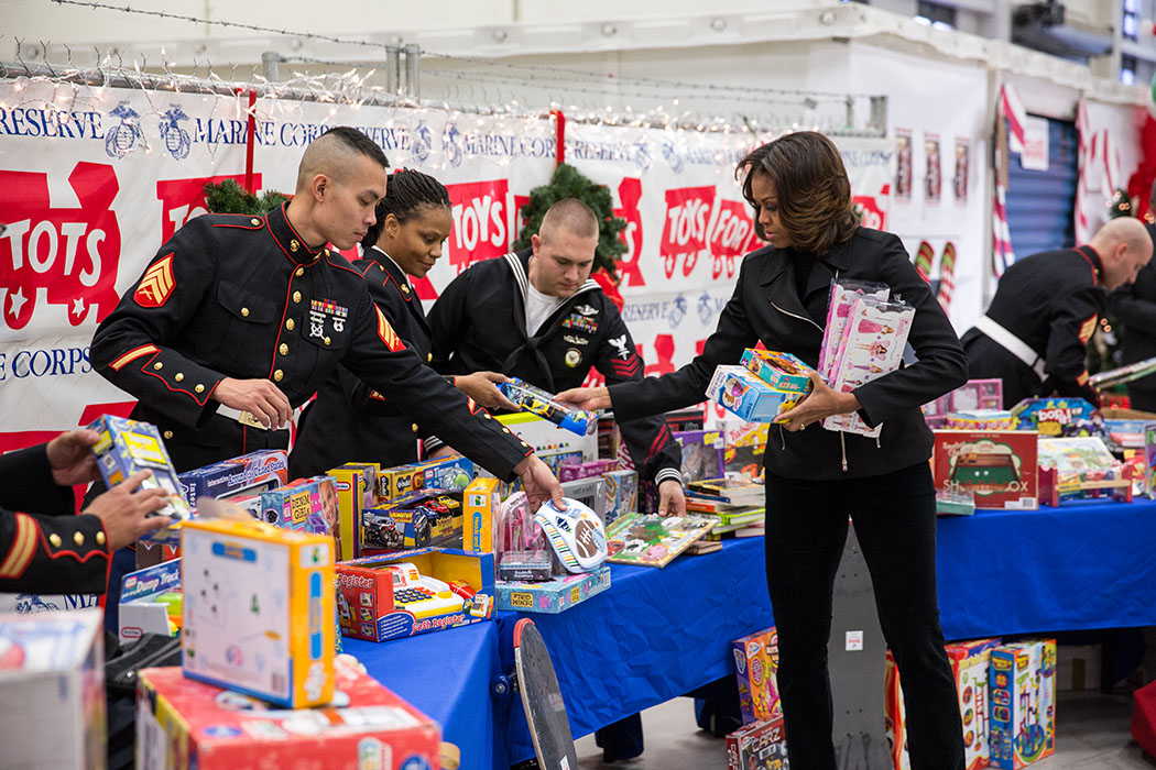 First Lady Michelle Obama participates in the sorting of toys