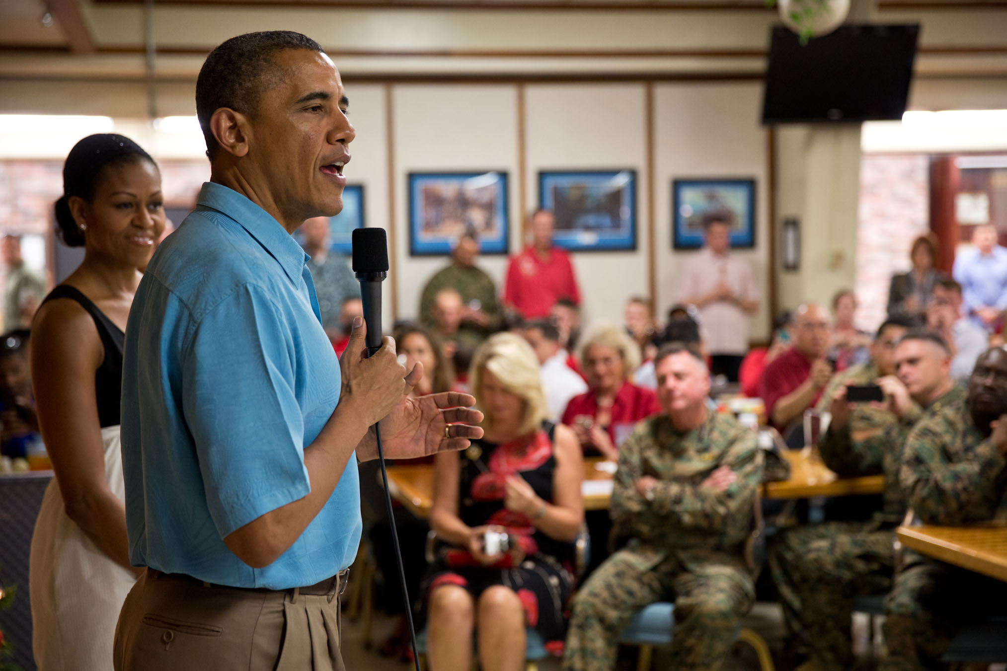President Obama and First Lady Michelle Obama visit with members of the military at Marine Corps Base Hawaii, Dec. 25, 2012