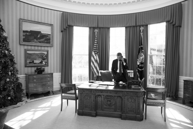 President Obama Talks on the Phone in the Oval Office