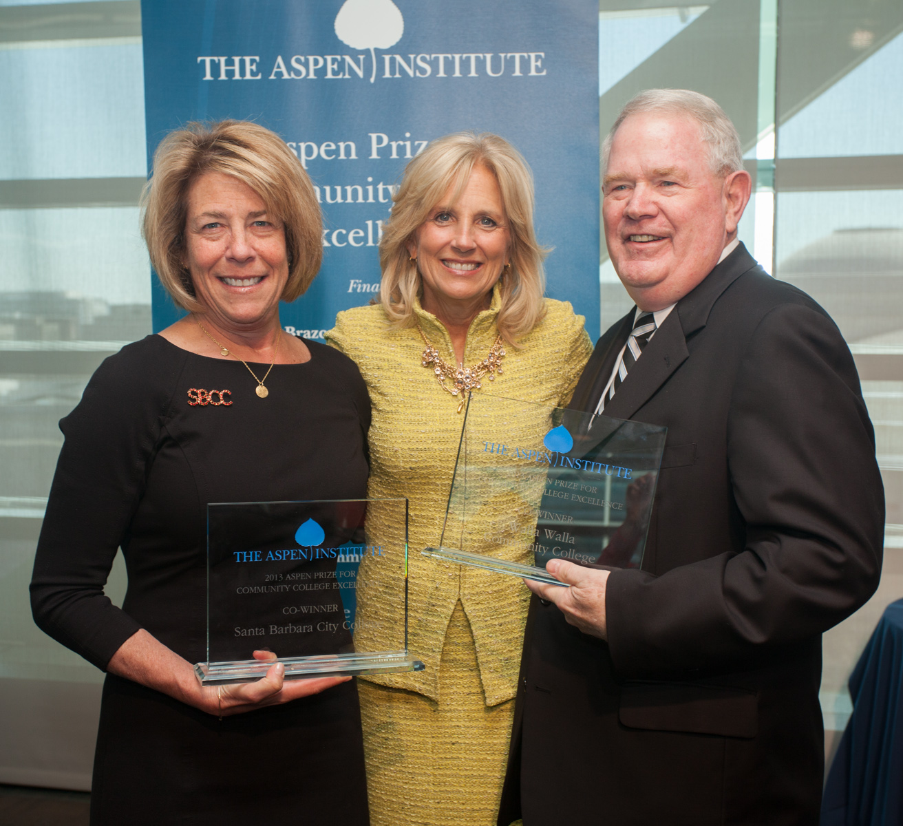 Dr. Jill Biden with the co-winners of the 2013 Aspen Community College Excellence Prize