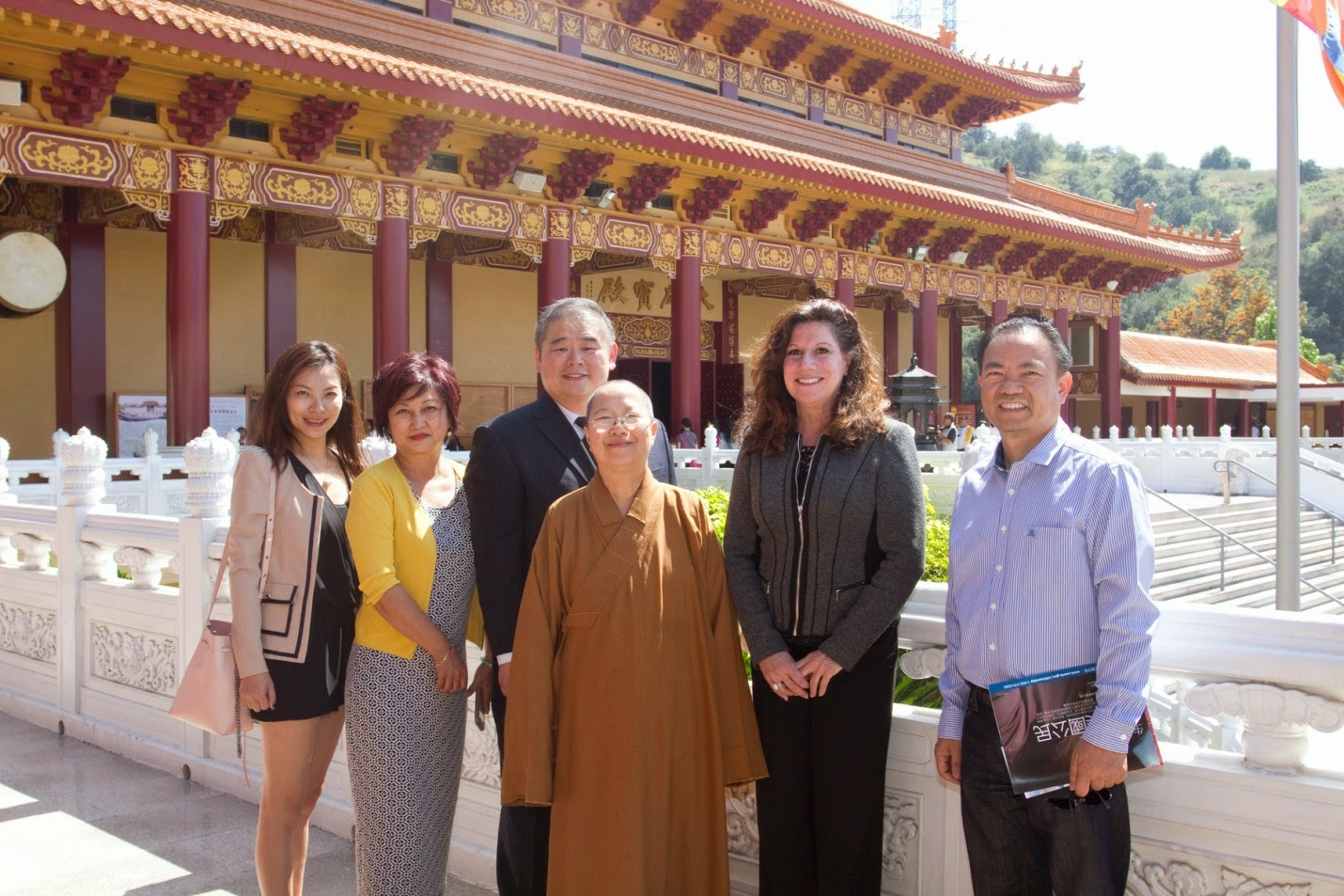 USCIS District Director Susan M Curda with Paul Chang at the Hsi Lai Temple
