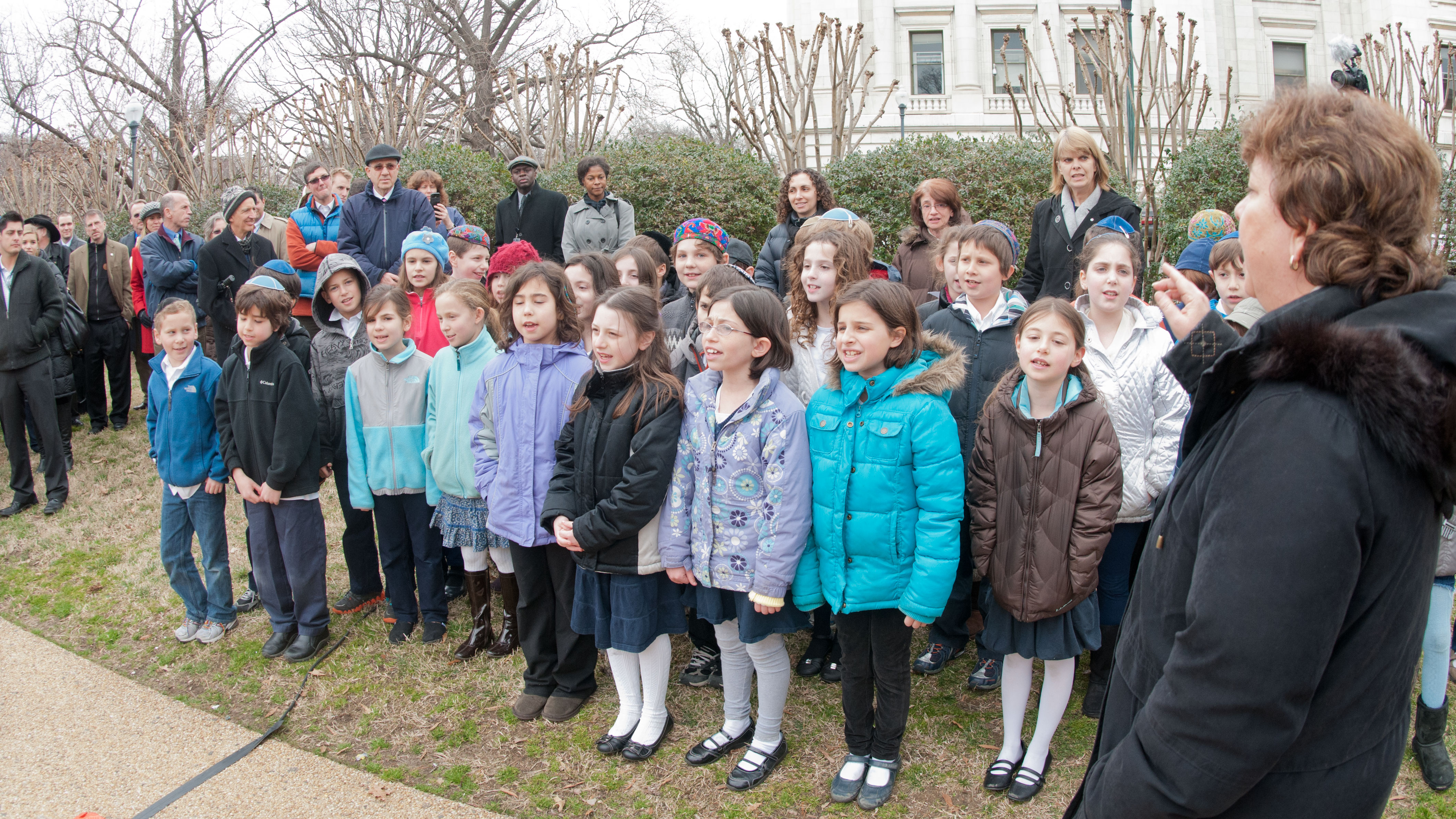 3rd Grade Class of the Jewish Primary Day School of the Nation's Capitol singduring the Celebration of Tu B'Shevat