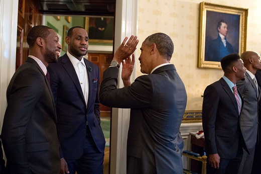 President Barack Obama talks with 2013 NBA Champion Miami Heat players