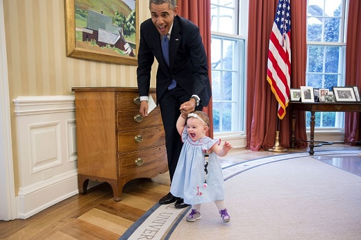 President Barack Obama walks with Lincoln Rose Pierce Smith