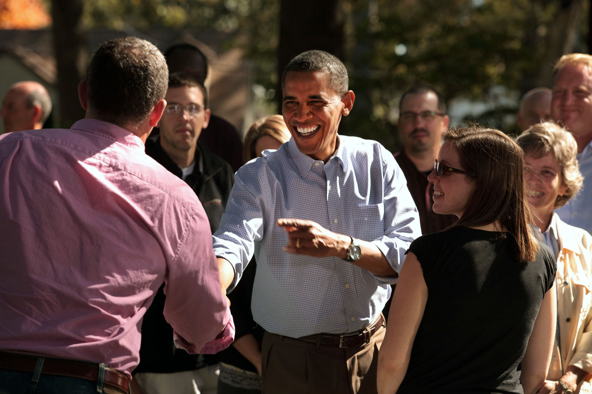 President Barack Obama Shakes Hands with Neighborhood Families in the Backyard of Jeff and Sandy Clubb's Home in Des Moines, Iowa