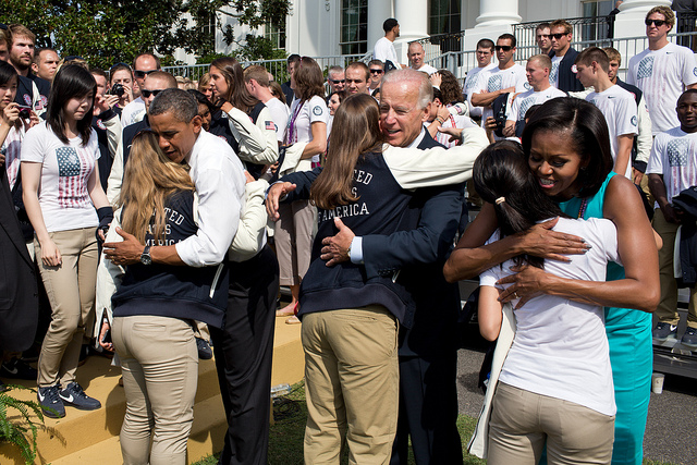 President Barack Obama, First Lady Michelle Obama and Vice President Joe Biden greet athletes