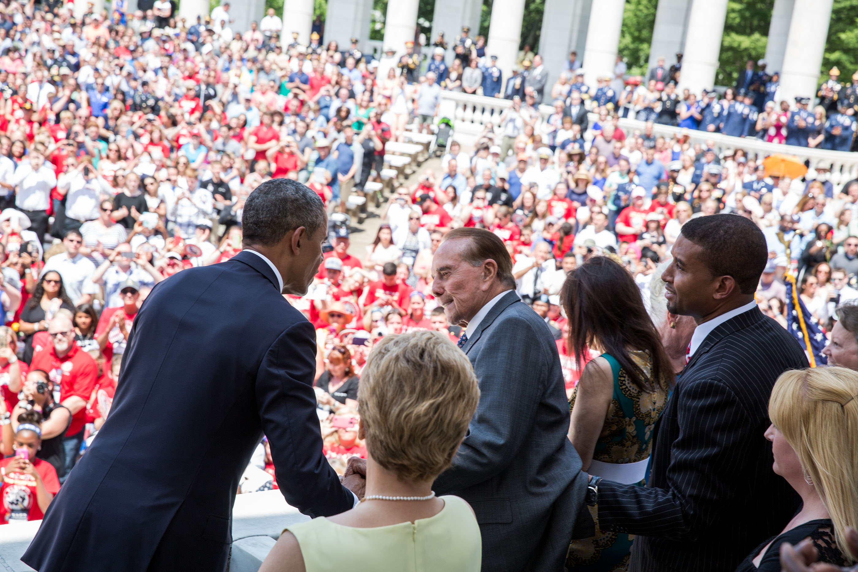 President Obama greets former Senator Bob Dole at Arlington