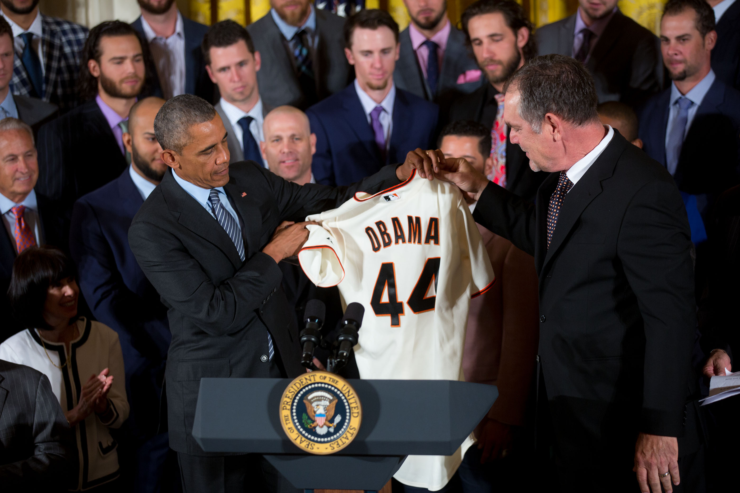 President Obama Holds a 2015 Giants Jersey