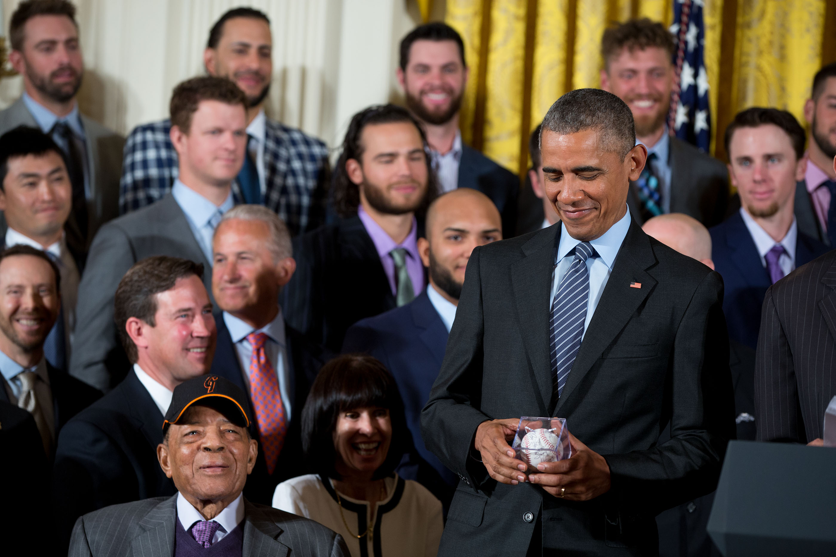 President Obama holds a Giants baseball