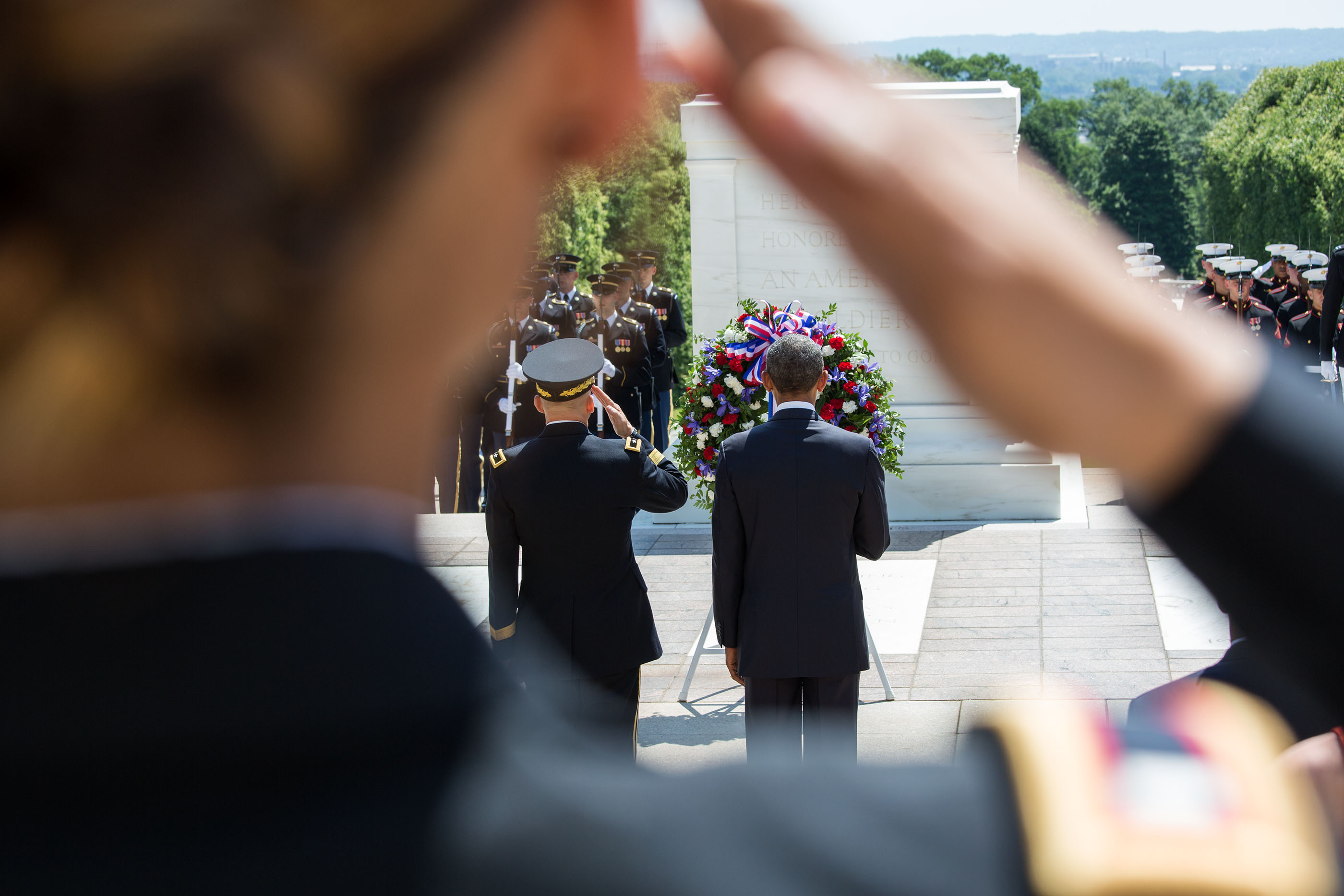 President Obama participates in a wreath laying ceremony at the Tomb of the Unknown Soldier