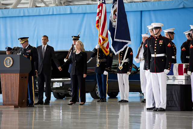 President Barack Obama stands with Secretary of State Hillary Rodham Clinton during the transfer of remains ceremony