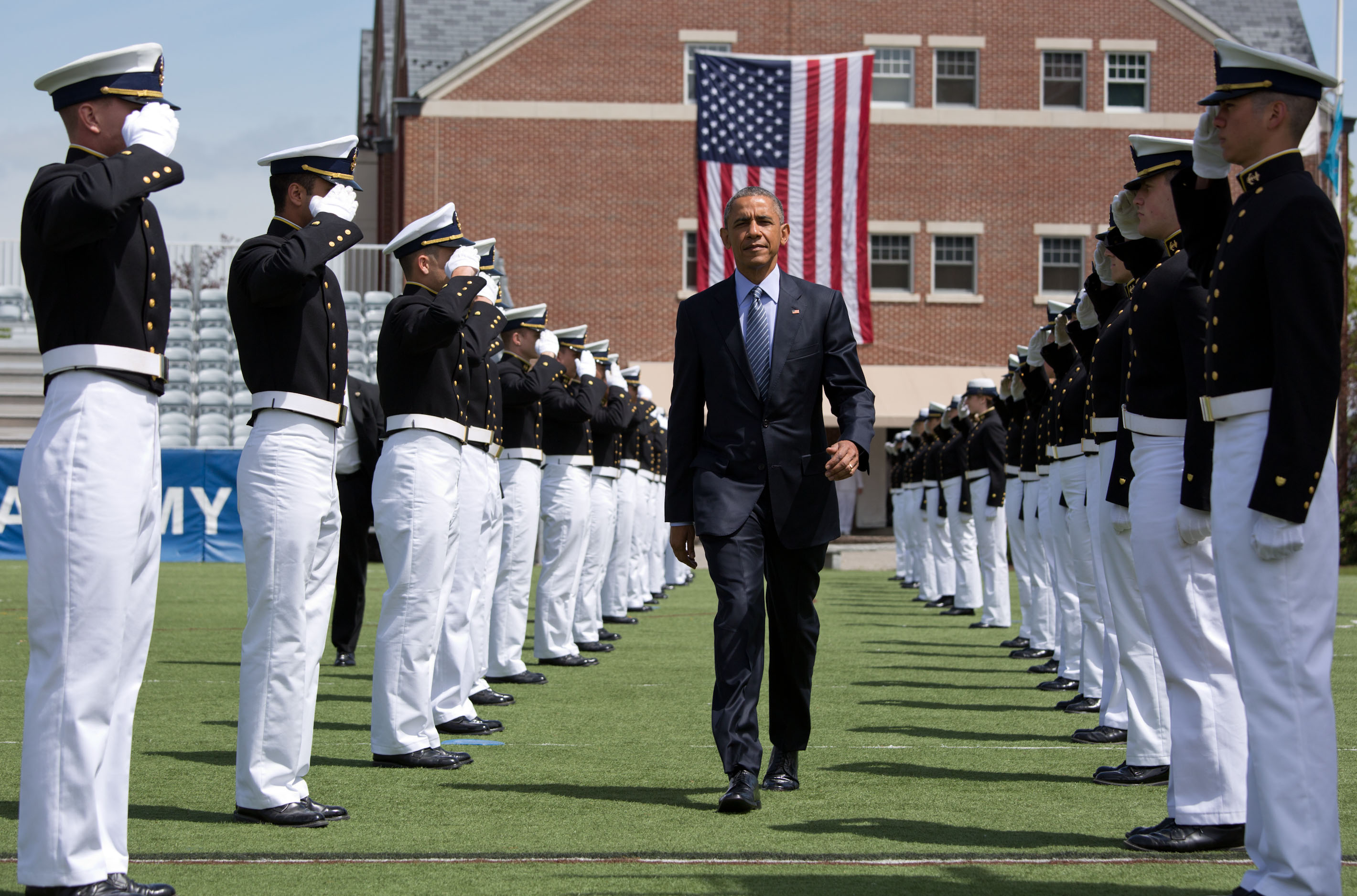 President Obama walks through an honor cordon