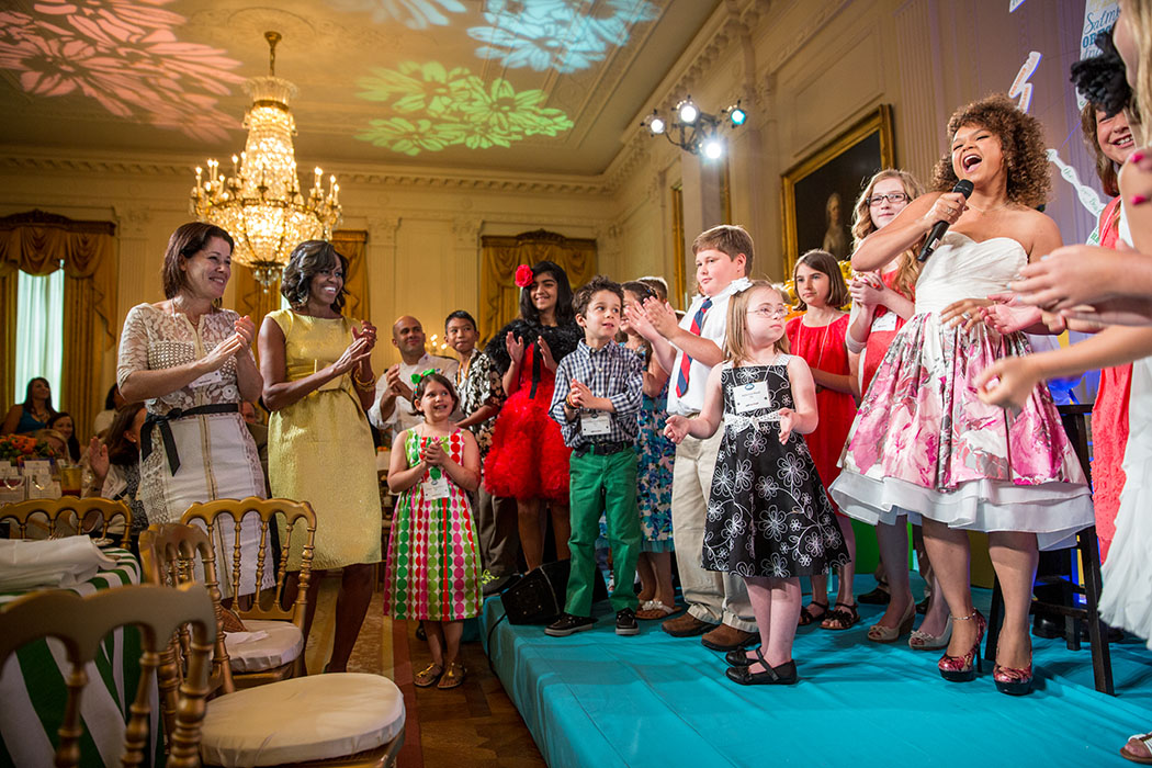 First Lady Michelle Obama dances as Rachel Crow performs during the Kids' State Dinner