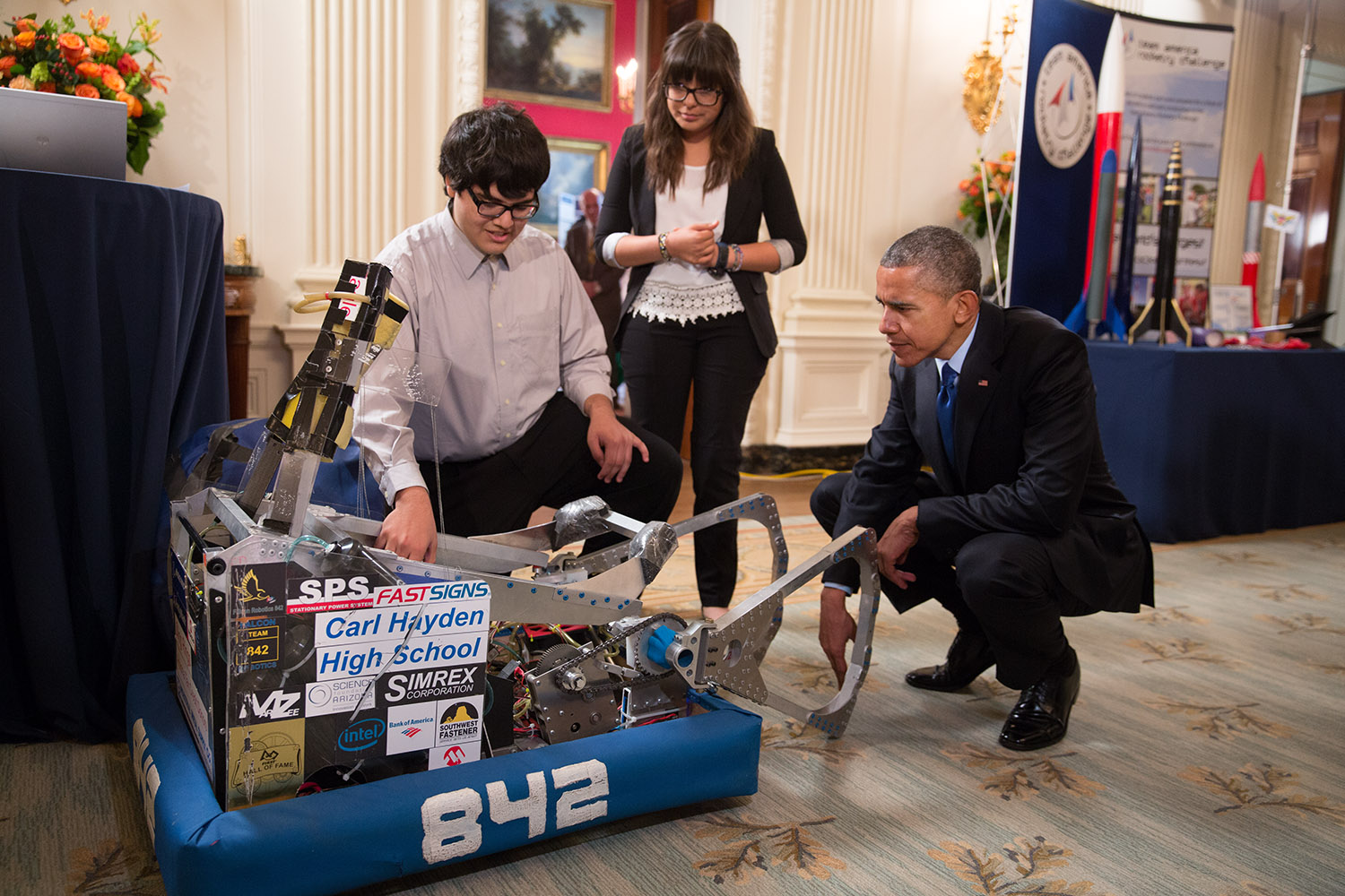President Obama looks at two Arizona students' robot at the fifth annual White House Science Fair