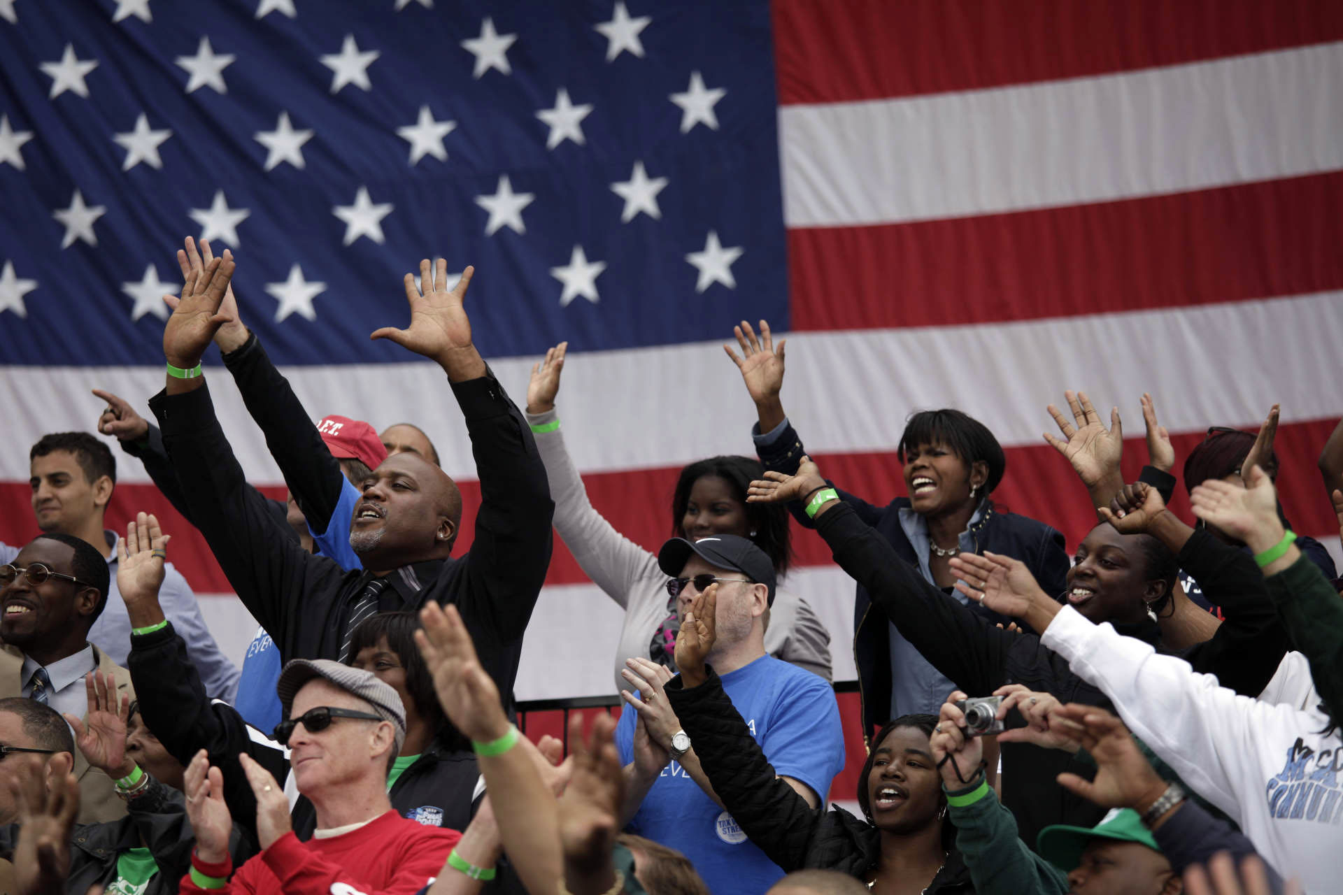 eople wave as President Barack Obama addresses the Labor Day celebration in Detroit, Mich.
