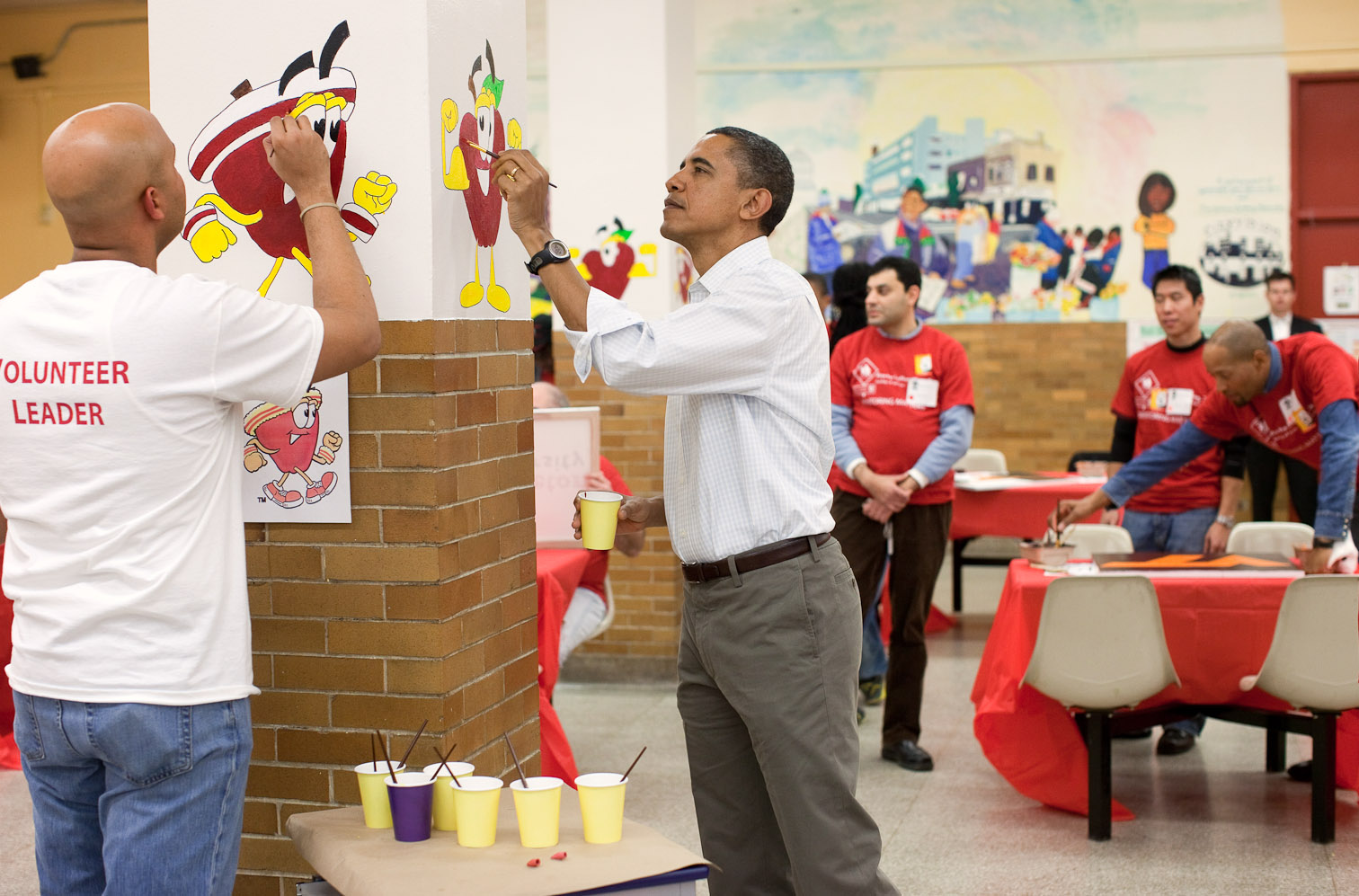 President Barack Obama Helps Paint Pictures of Fruit During a Service Project on Martin Luther King Day