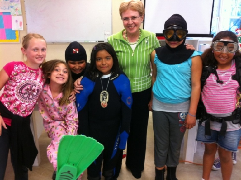 Girls in Santa Barbara, CA take a break from learning about oceanography during a visit with Dr. Jane Lubchenco