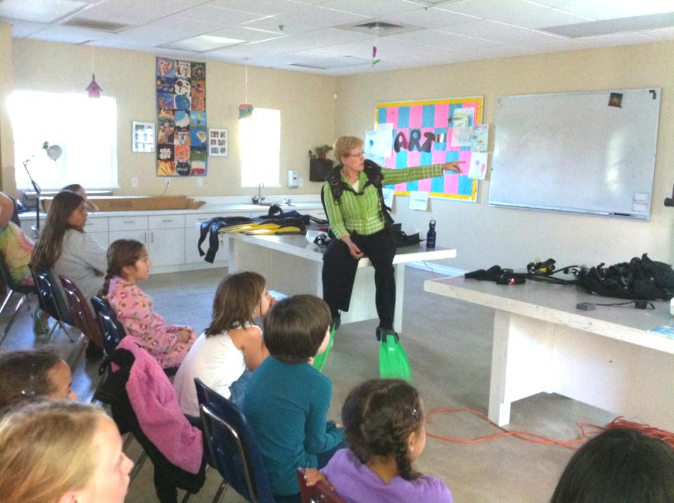 Dr. Jane Lubchenco demonstrates an ocean explorer's toolkit to students
