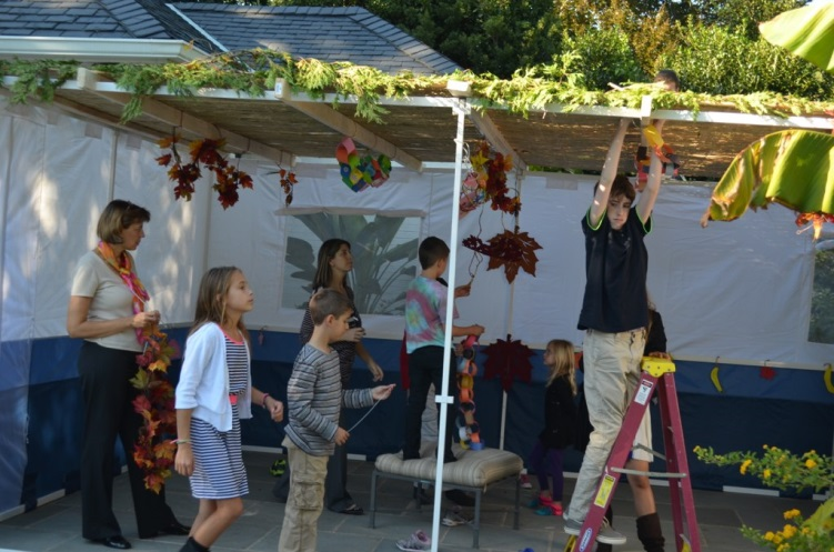 After the sukkah was built, a group of Jewish children with disabilities from local area schools, joined by their parents, came to decorate the sukkah. . .