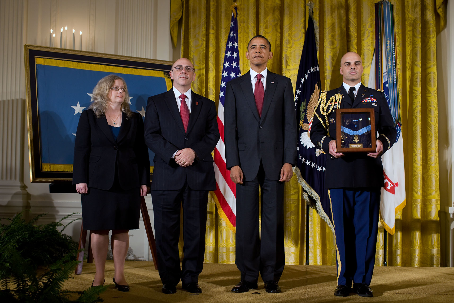 President Barack Obama Stands with Phil and Maureen Miller, Parents of Staff Sergeant Robert J. Miller, as the Medal of Honor is Awarded Posthumously to their Son