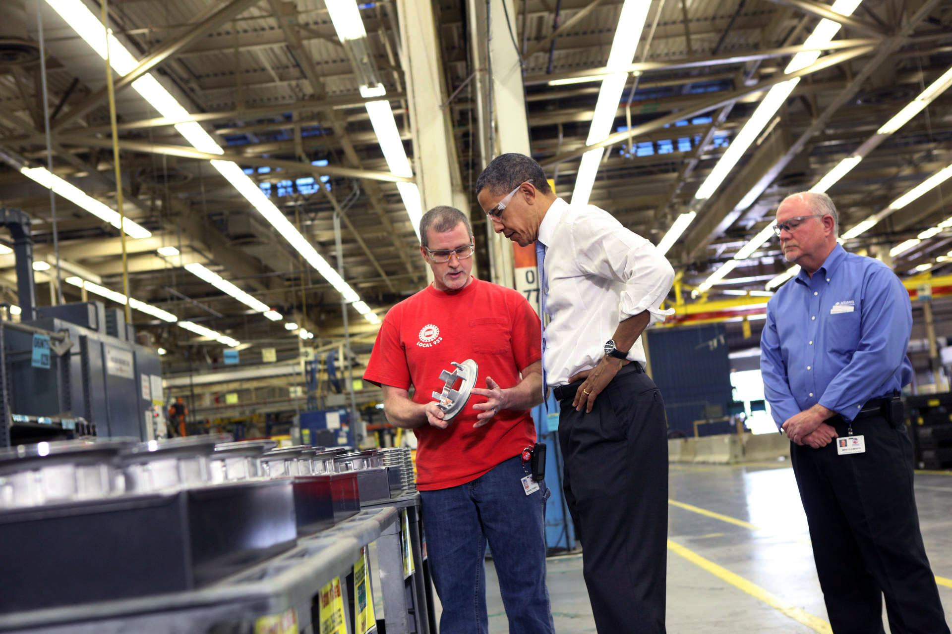 President Barack Obama Examines a Part During a Tour of Allison Transmission in Indianapolis, Indiana