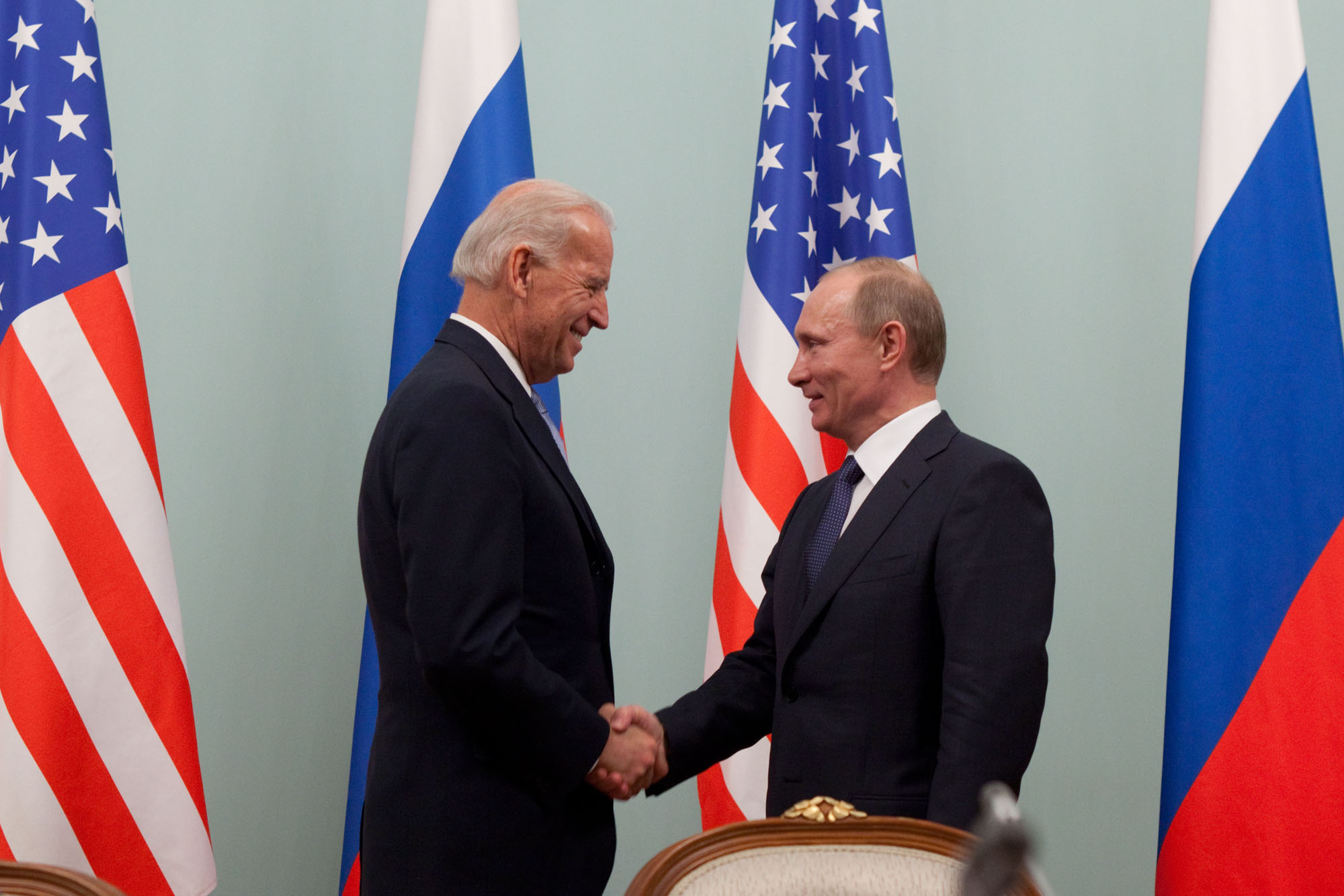 Vice President Joe Biden greets Russian Prime Minister Vladimir Putin at the Russian White House