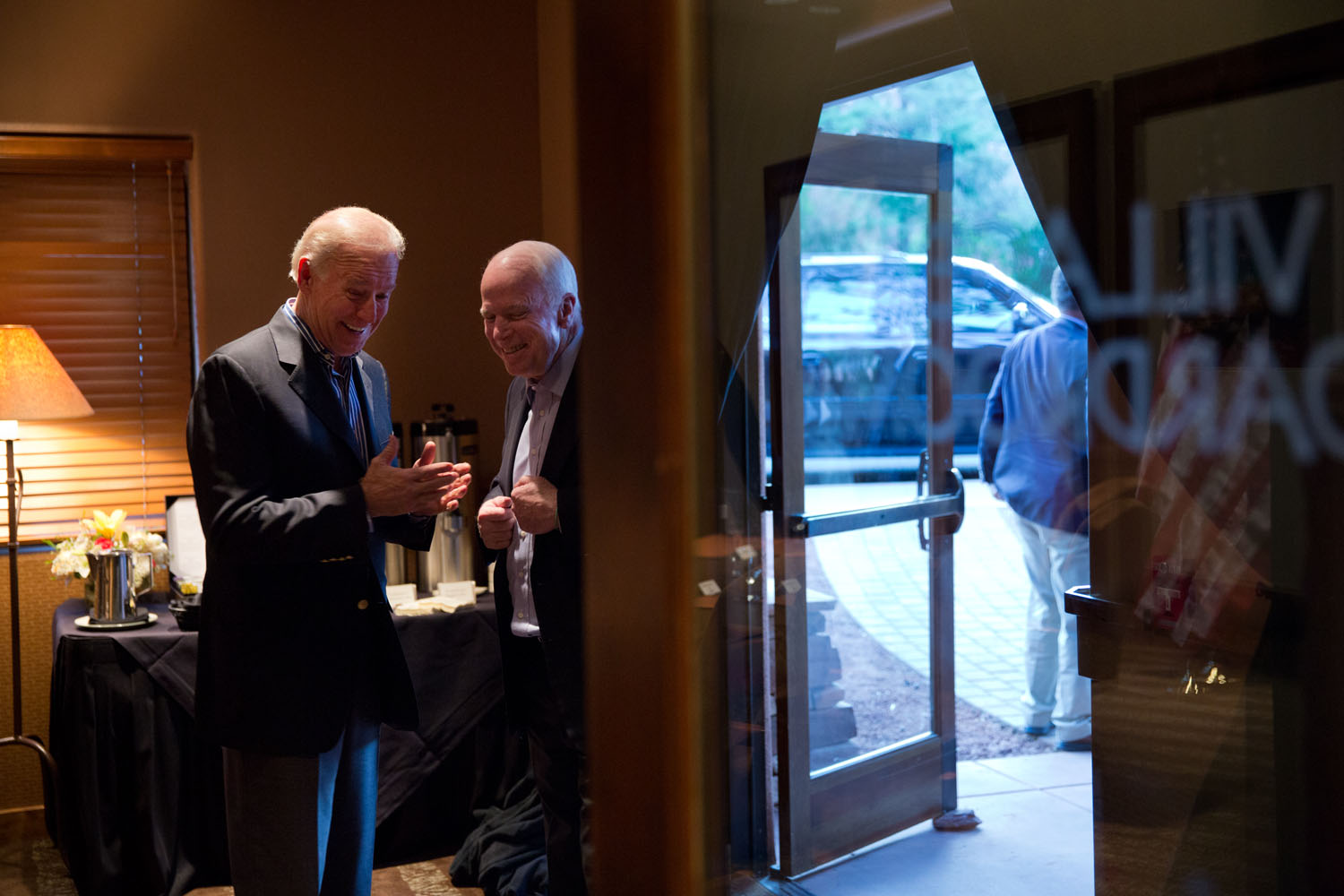 Vice President Joe Biden talks with Senator John McCain