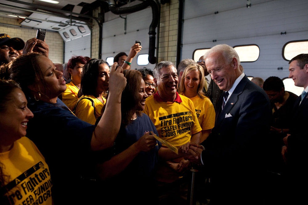 Vice President Joe Biden greets members of the audience after speaking in Flint, Michigan