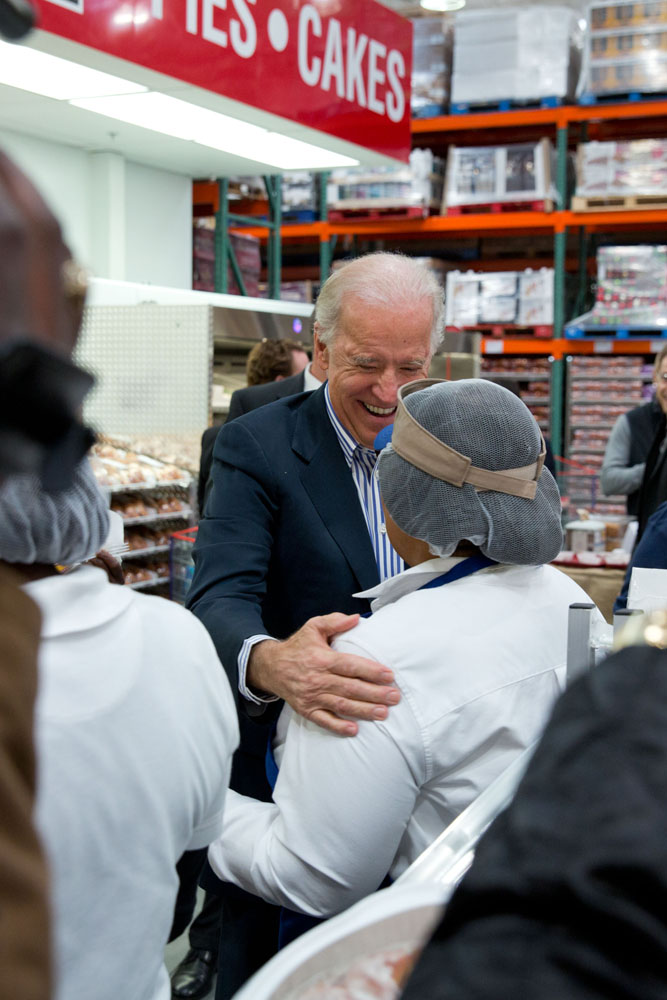 Vice President Joe Biden greets workers in the bakery section at the newly opened Costco