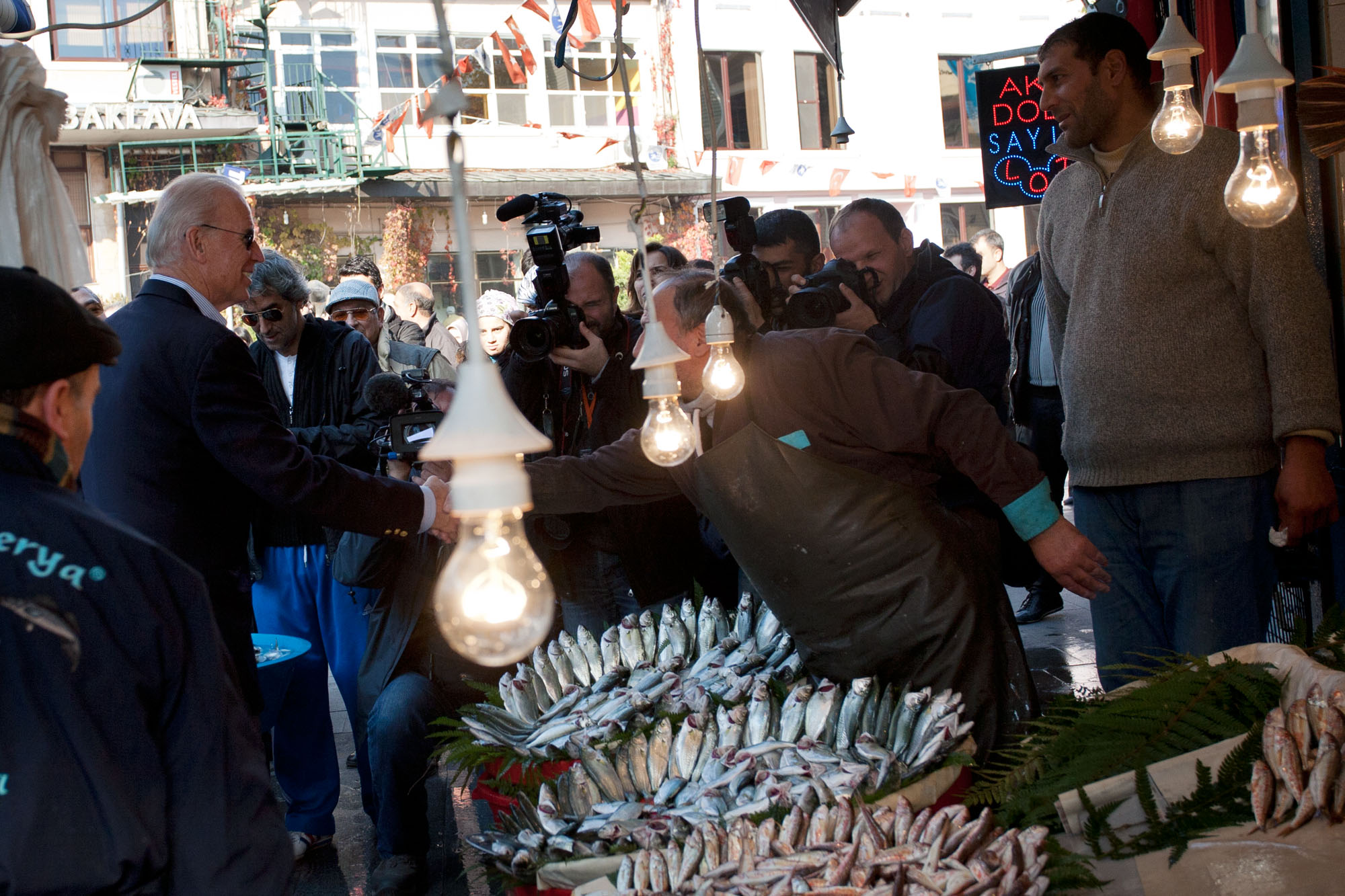 Vice President Joe Biden shakes hands with a fish monger in Istanbul