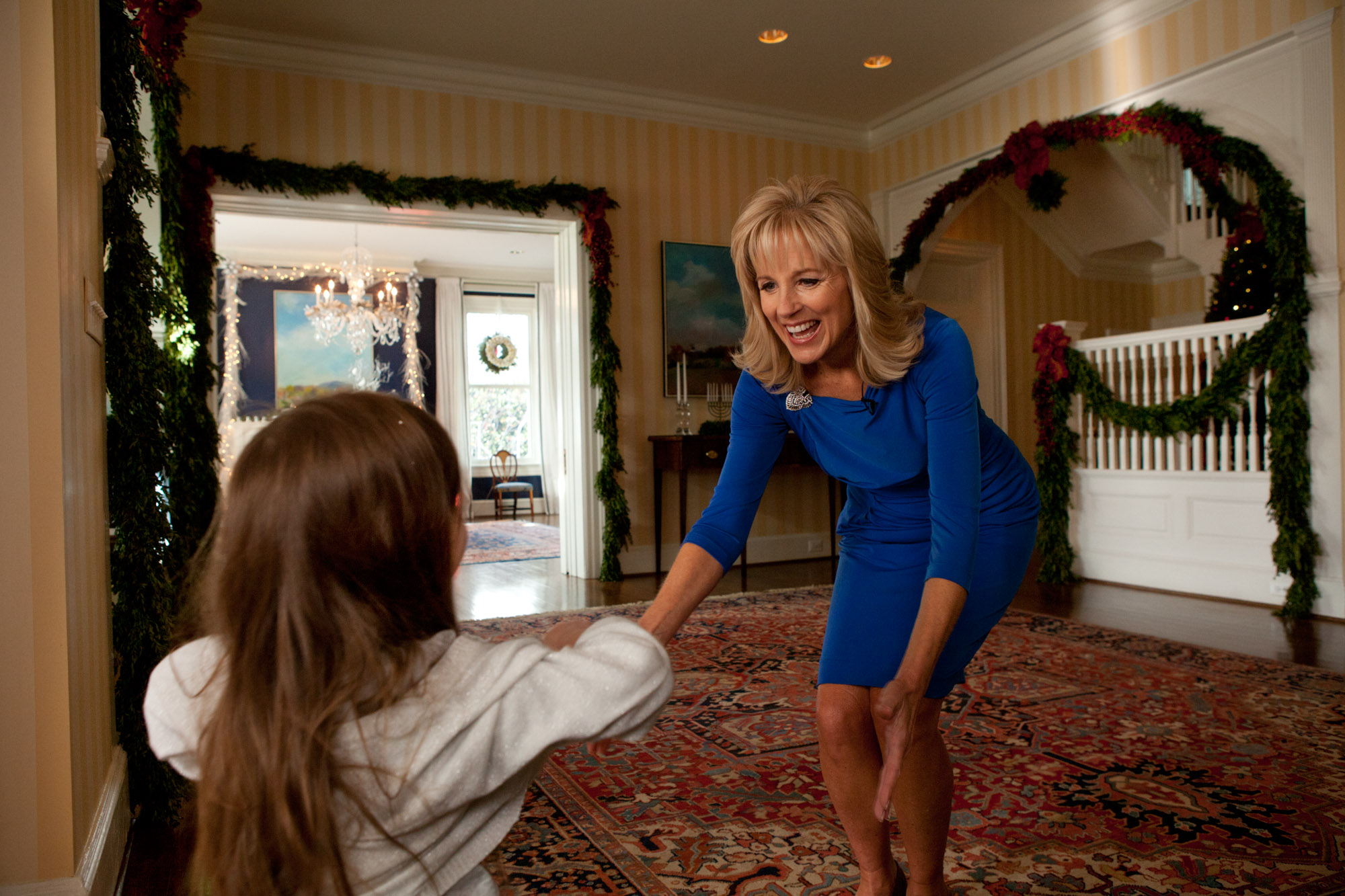 Dr. Jill Biden greets a student arriving at the Vice President's Residence