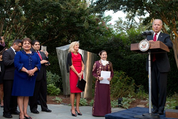 Vice President Joe Biden speaks at a Hispanic Heritage Month reception with Dr. Jill Biden and high school senior Ashley Guzman