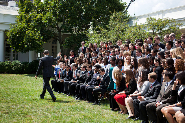 President Obama waves goodbye after talking with summer interns from the White House Internship Program