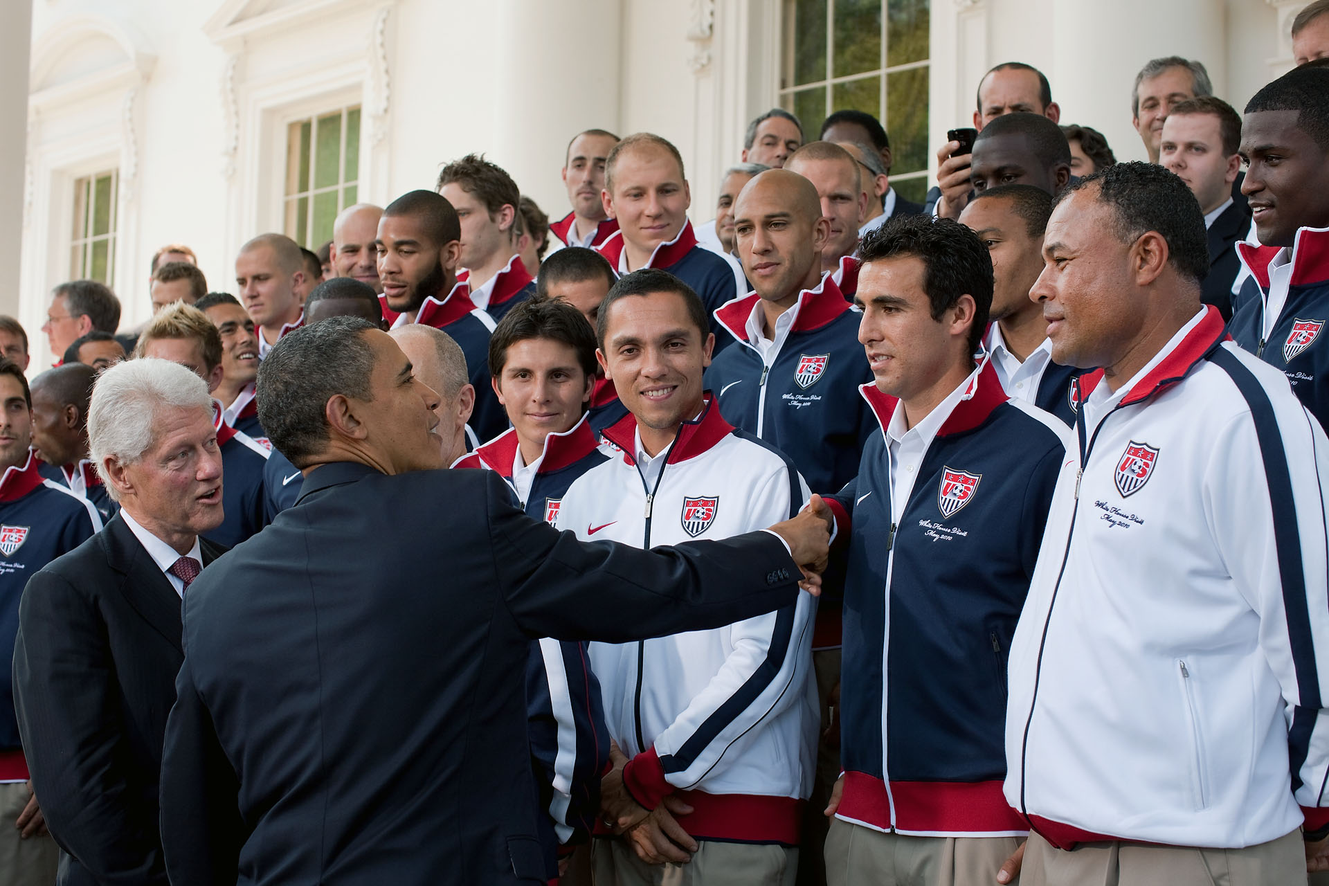 President Obama and President Clinton Shake Hands with the US World Cup Team