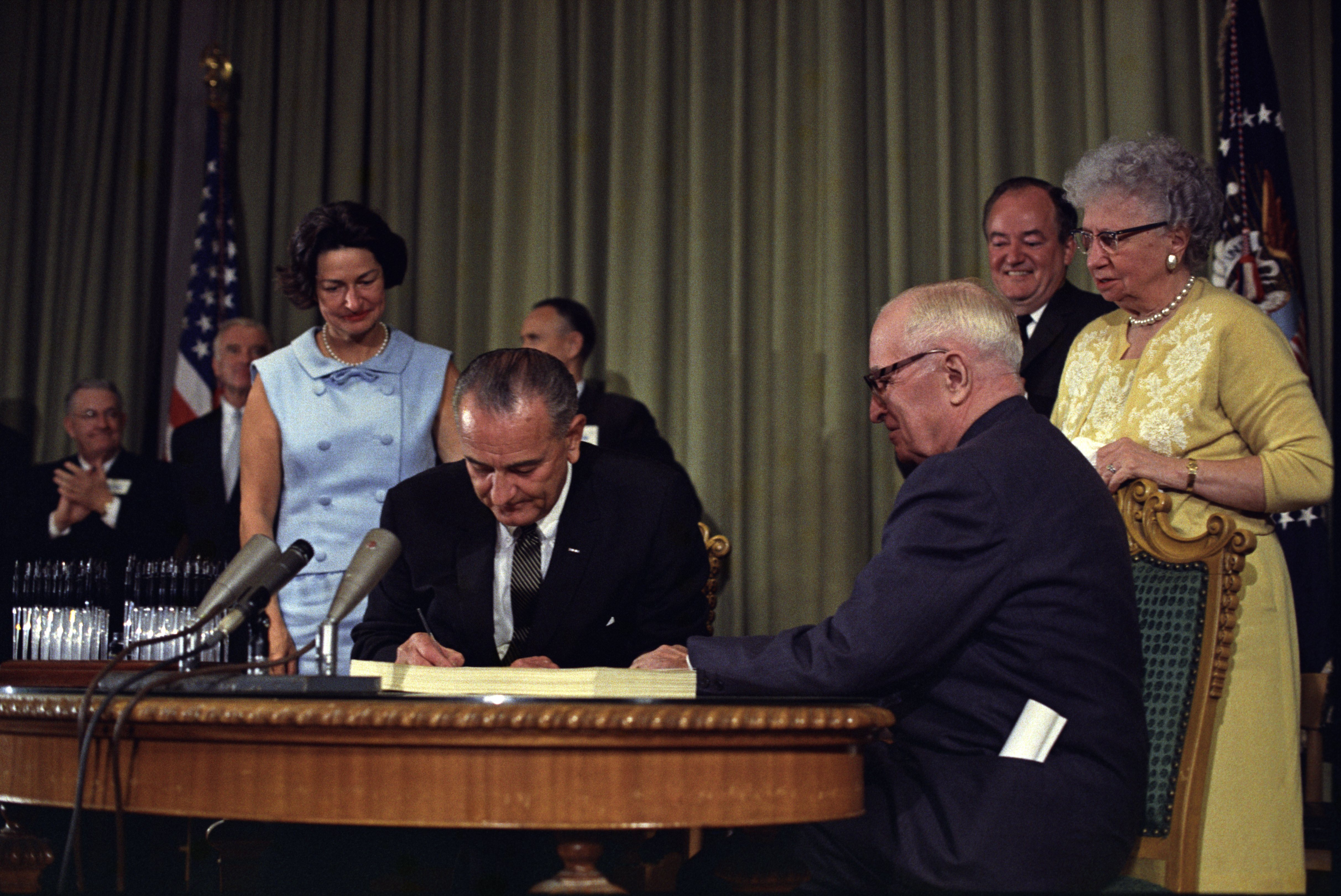 Lyndon Johnson signing Medicare bill, with Harry Truman, July 30, 1965